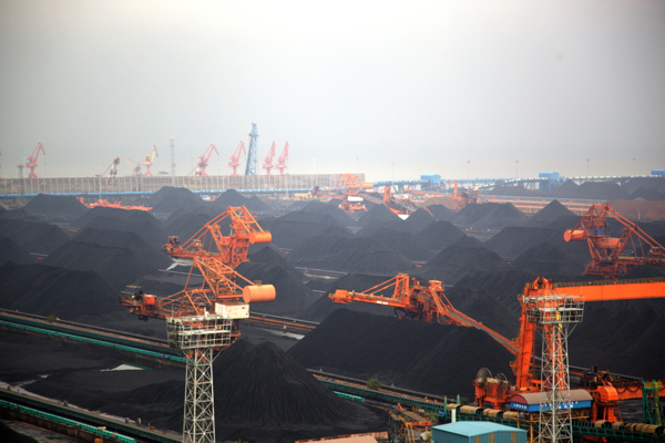 China lowers coal export levies to boost ailing economy