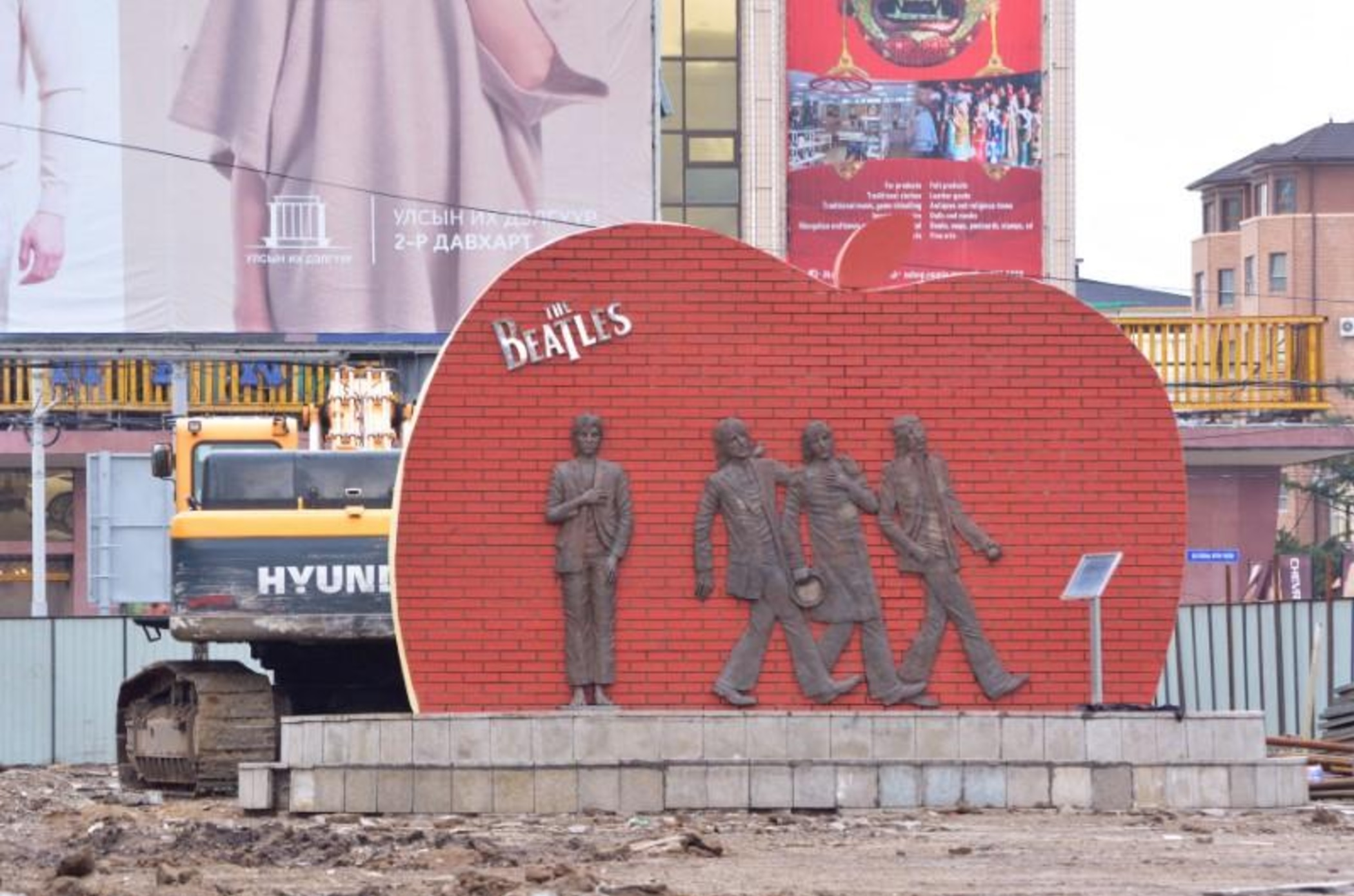 'Let it be': Mongolians protest as bulldozers threaten Beatles monument